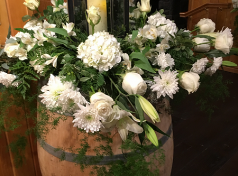 Wooden barrel with white flowers