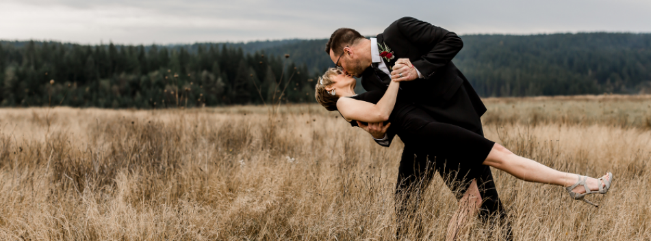 Grassy Meadow Wedding Picture of Couple Kissing