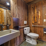 Lower Level Rest Room Rustic Walls with Hand Carved Trees